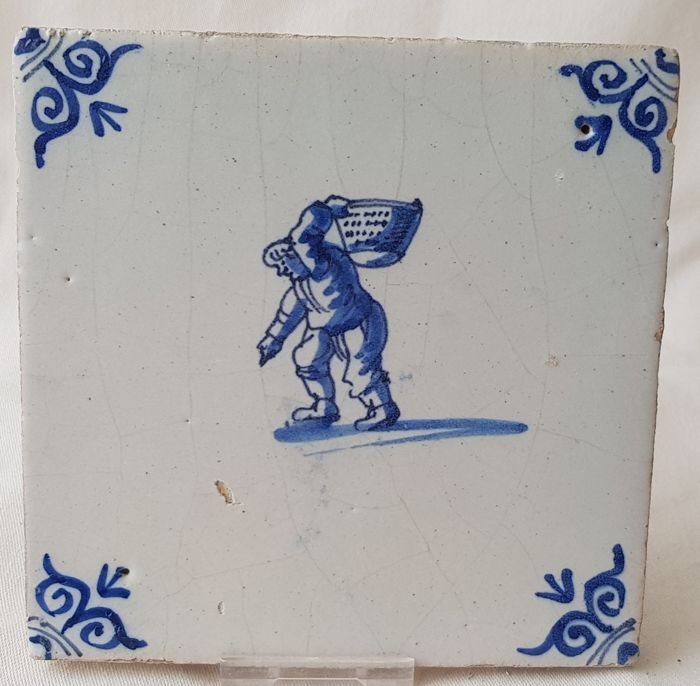 Tile with man with potato basket, special depiction - Catawiki