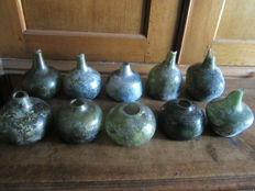 A collection of 10 belly bottles of dutch union bottles, Netherlands, 17th/18th century glass