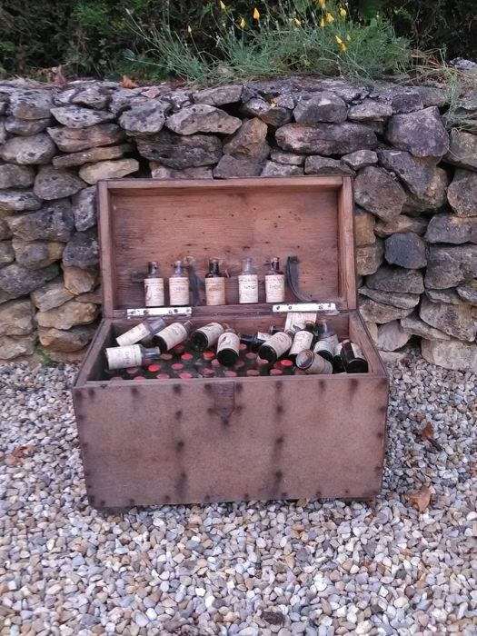 "Chest with Old ""le Merle"" Varnish Bottles  late 19th - early 20th century."