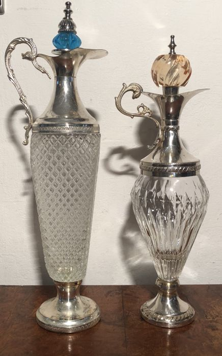 2 silver plated crystal decanters.