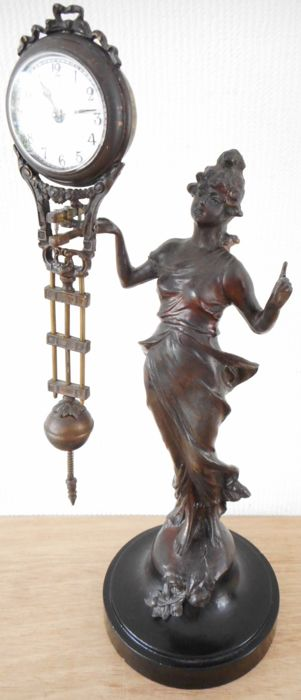 Beautiful lady with graceful swing clock. Material lady unknown. Clock made of copper and brass.