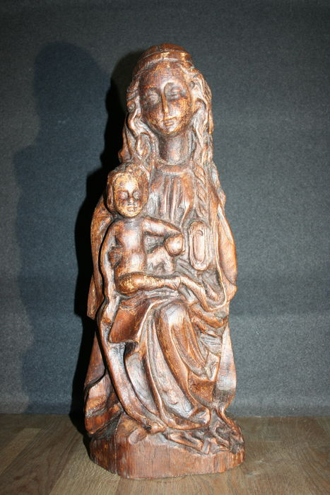 Antique hand-made solid wooden church sculpture of Madonna and child