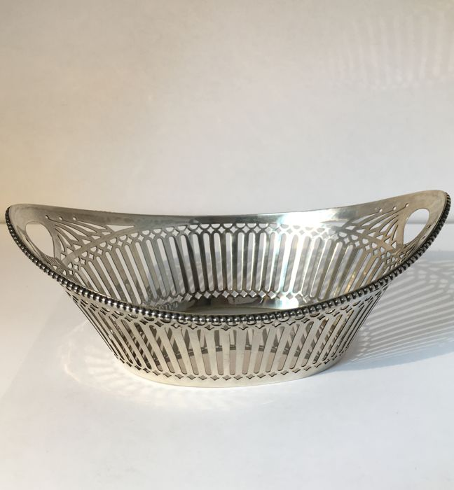 A 2nd grade content silver chocolate basket with pearl rim