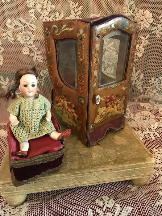antique doll planquin -  from painted tin on the outside with great images
