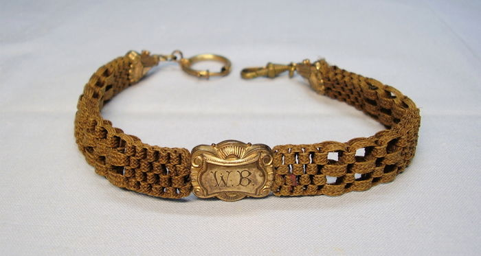 898b12d55e0cc Antique Victorian watch chain made of a hair braid bracelet with rolled ...