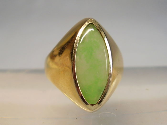 Antique, solid 18 kt gold ring with light green natural jade navette weighing 5 ct