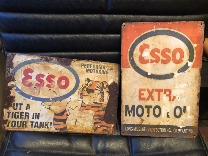 a very curious ESSO lot: 2 advertising's Put a Tiger in your tank and Extra Motor Oil = 21th century