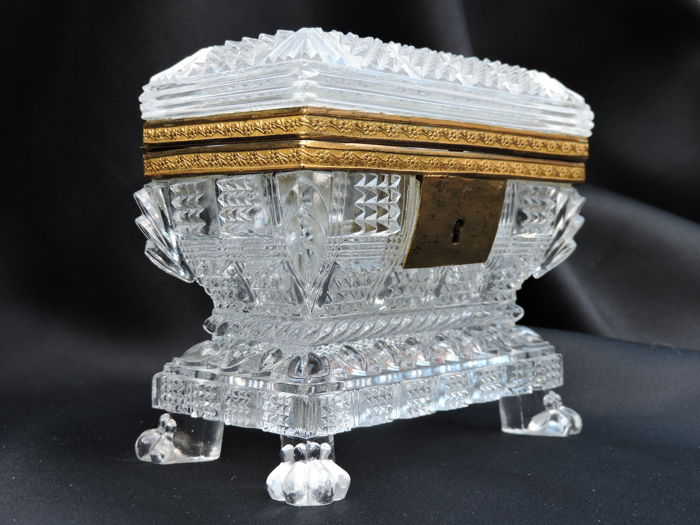 Crystal sarcophagus box with a gold-coloured frame