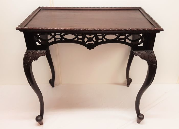 A mahogany wood table with beautiful carvings 20th century france
