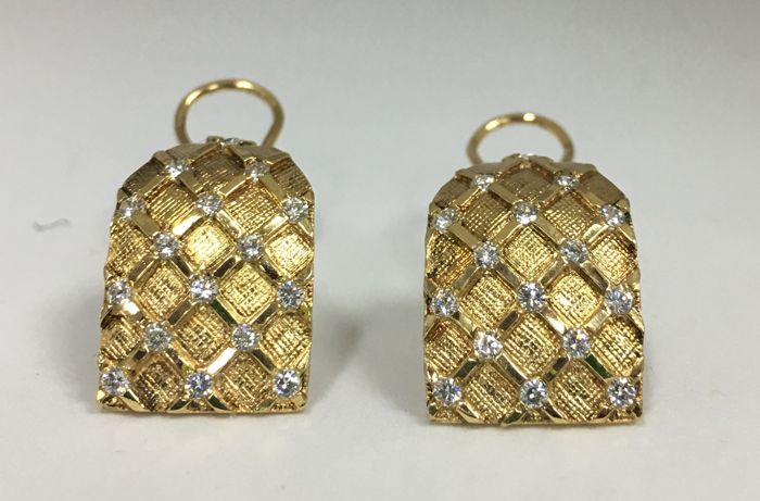 Omega clip-on earrings made of 18 kt yellow gold with 32 unique cut diamonds, approximately 0.64 carat in total
