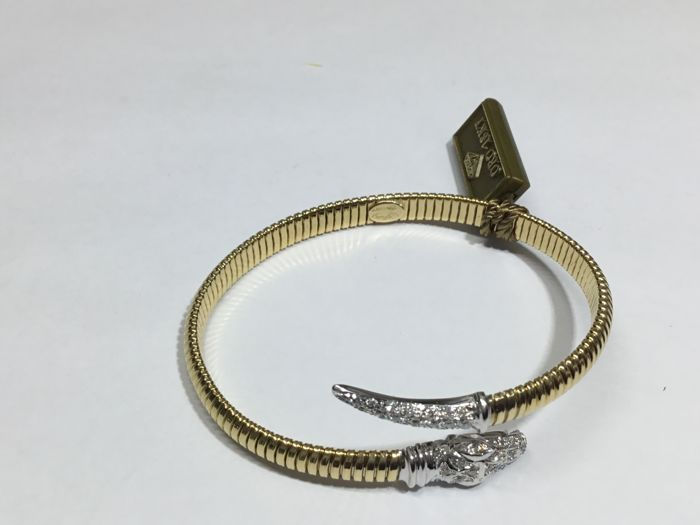 18 kt gold bracelet by 'Rudy' with diamonds totalling around 0.60 ct, G/VS, size 18/19