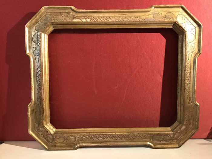 """Cabaret"" mirror frame made of wood, gilded with gold leaf and decorated with burin, Italy, 19th century"