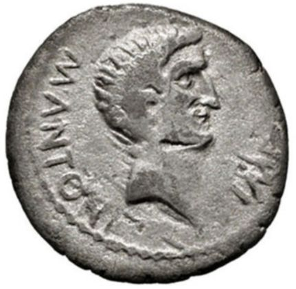 Roman Republic -  Military Mint moving with Antony in Greece. Rev: Facing head of Sol in a temple of two columns. - Silver