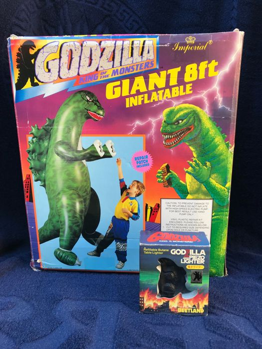 Godzilla King of the Monsters two special collector items One HUGHE inflatable Godzilla NEW IN BOX and a Piezo lighter/ table lighter - in original package - lighter has never been used