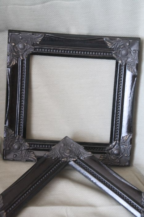 2 unusual, identical black photo frames in combined style