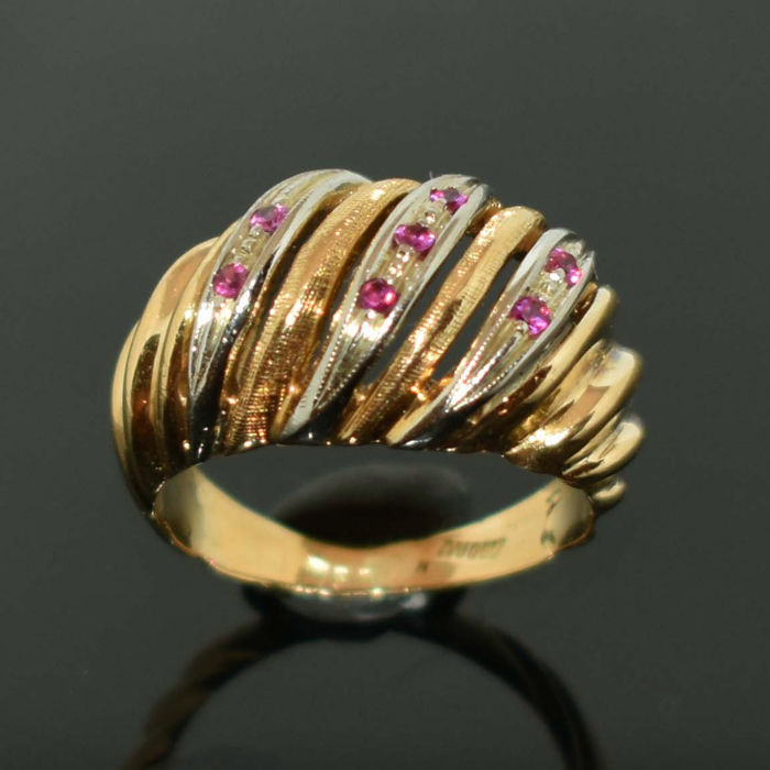 18 kt yellow/white gold ring with 7 rubies in mint condition