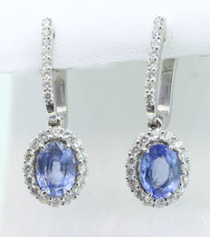 Earrings with 2 shaped sapphires 2.00 ct total and 48 diamonds 1.00 ct total. 14K Dimensions: 7.20 X  5.20 mm
