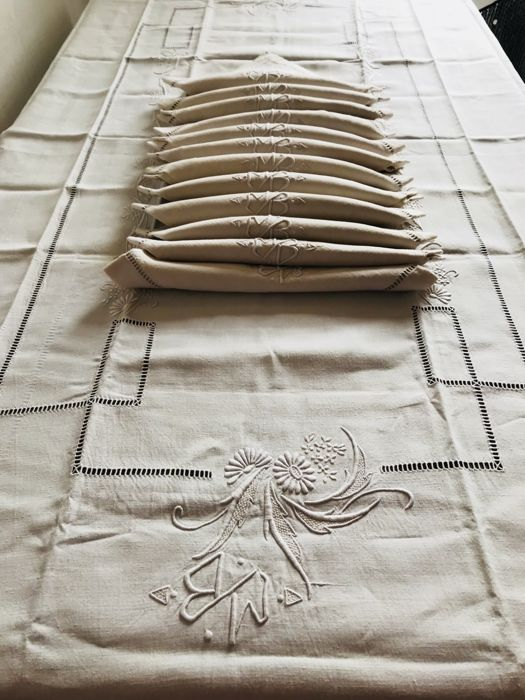 Old table set consisting a large tablecloth and 12 hand embroidered granite linen serviettes with monogram