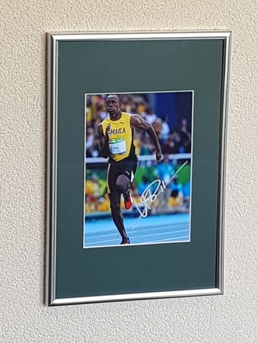 Usain Bolt - Olympic Legend 100 en 200 m - fantastic hand signed framed photo + COA.