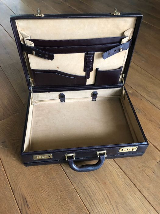 Great vintage Burgundy leather suitcase with light suede interior and Swiss Amiet locks. The Netherlands, 1970's