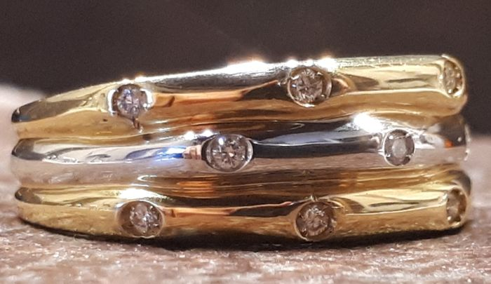 """18 kt gold ring Two-tone, brand """"Gemoro"""", diamonds 0.11 ct, weight 6.80 g Size: 17 mm"""