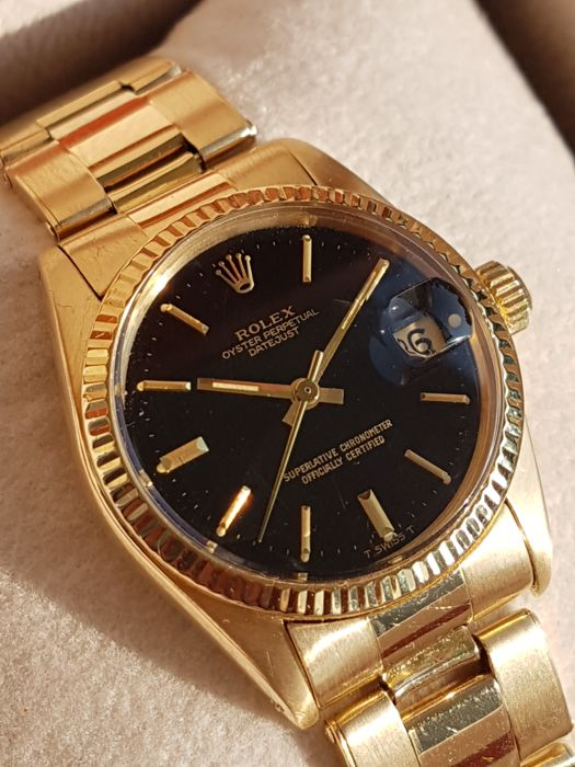 Rolex , Oyster Perpetual Datejust , black gilt dial , Ref. 6827 , yellow  gold 18K , Women , ca.1981 , Catawiki