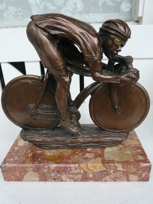 Beautiful bronze sculpture of a cyclist on marble base