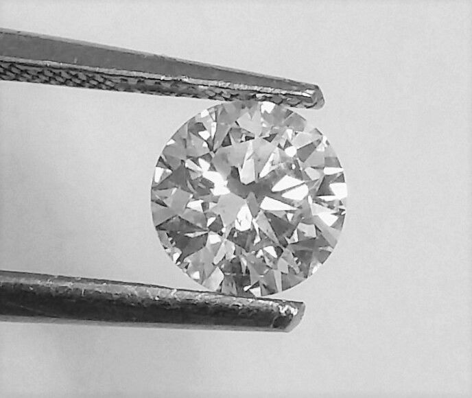 Round Brilliant Cut  - 0.74 carat - H color - VS2 clarity- 3 x EX - Comes With AIG Certificate + Laser Inscription On Girdle.