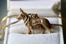 Handcrafted German Sterling silver pendant in form of dog on a crossed chain, both slightly gold-plated **No Reserve**