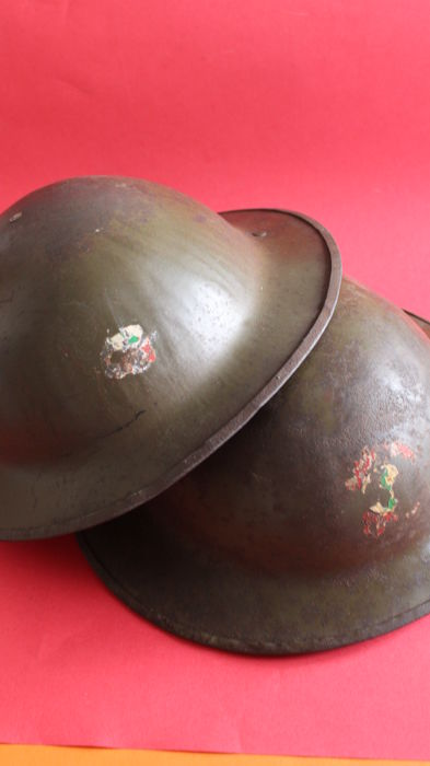 Two WW I British Brodie helmets one marked HS used at Portugal after the war