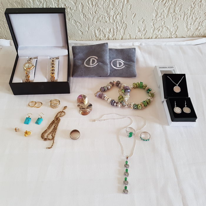 Collection of Gold and Silver jewlery, and a watch with bracelet