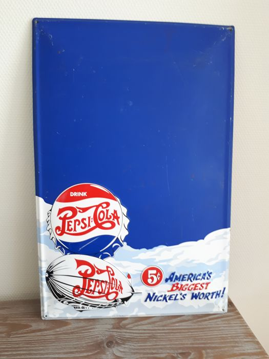 Large advertising sign for Pepsi Cola