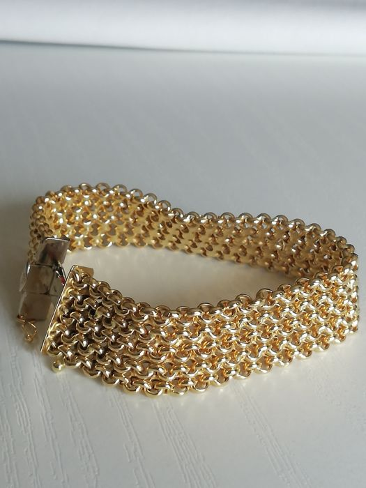 Women's bracelet in 18 kt gold. Length: 22 cm.