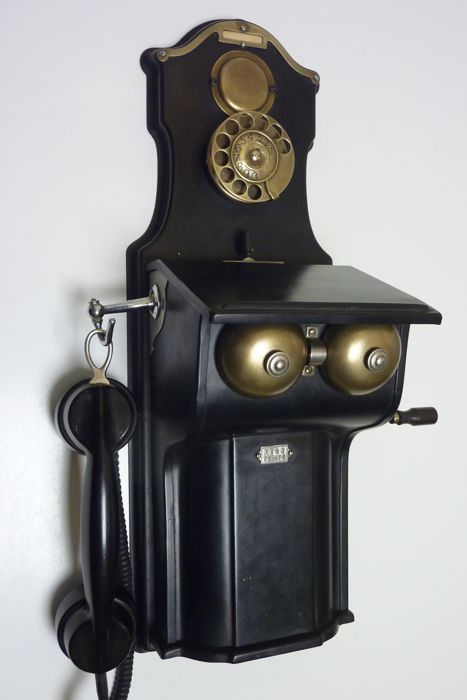 A crank metal telephone LM Ericsson black wall phone Swedish magneto, Sweden, early 1900's