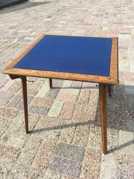 A Dutch oak folding card table - playing table with Royal Blue felt, Netherlands, early 20th century
