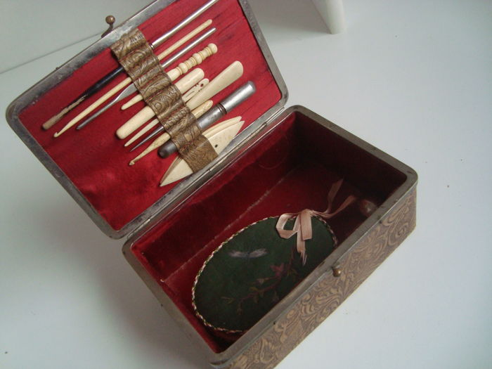 Beautiful worked leather sewing box with instruments made of bone and other