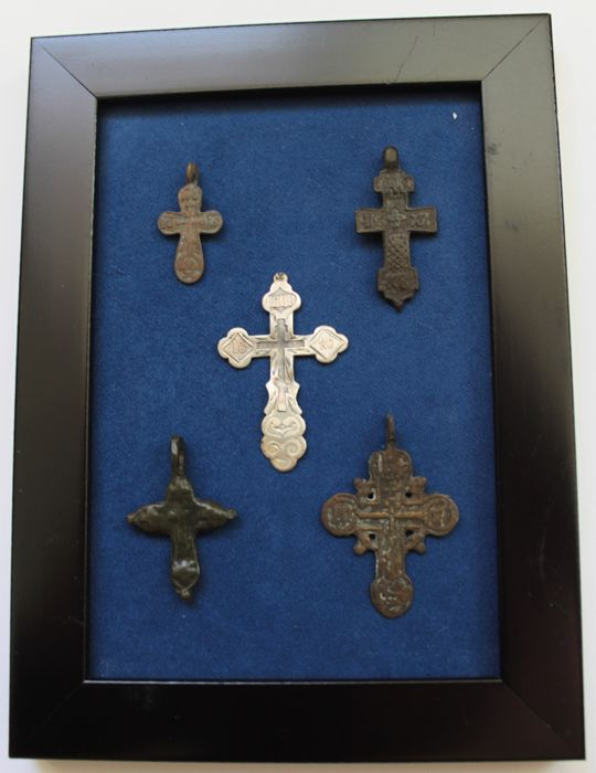Collection of 5 Medieval  crosses (4 bronze, 1 silver) in the frame.