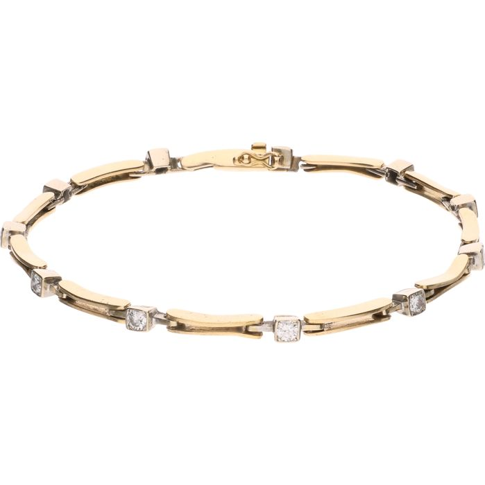 18 kt. - Yellow gold bracelet set with 11 brilliant-cut diamonds of approx. 0.88 ct in a white gold setting - Length: 21.2 cm