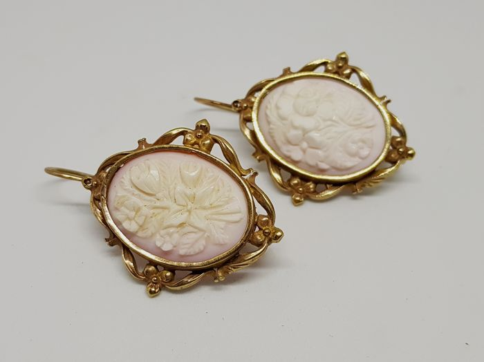 Antique earrings in gold with pink coral cameos, circa 1920