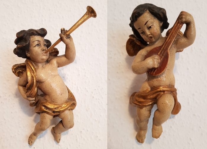 2 wooden angel / putto figures, approx. 17 cm