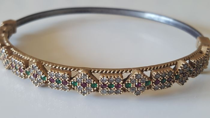 Intricate Art Deco bangle bracelet with rubies and emeralds and white sapphires