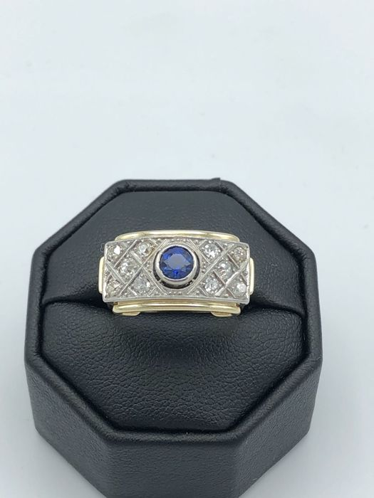 Sapphire 0.25 ct with old cut diamonds 0.50 ct