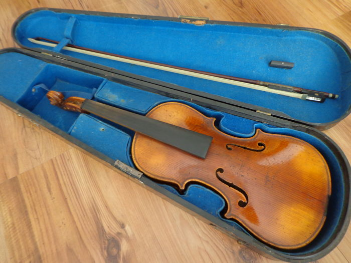 1/2 violin with note Antonius Stradivarius