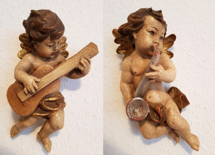 2 wooden angel / putto figures, approx. 21 cm