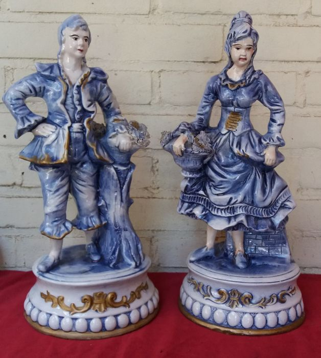 2 Italian statues of a man and woman, 1970-75