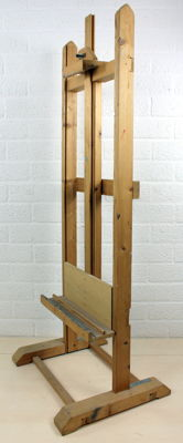 An adjustable wooden painter's easel, 20th century