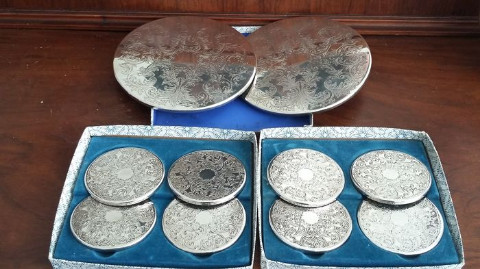 lot coasters&under plates silver plated made in england.