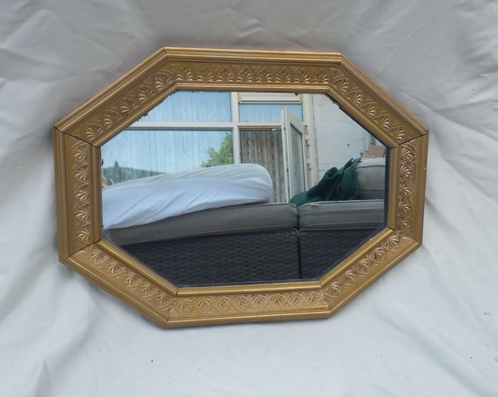 Antique mirror octagonal shape with gold plated solid wooden edge