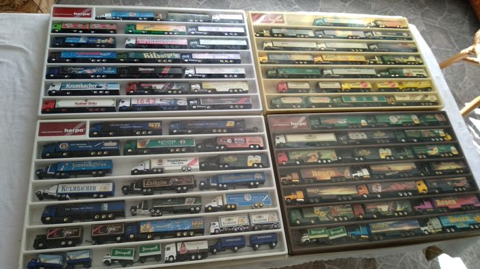 Numerous brands - scale 1/87 - lot of 83 models: Brewery lorries, Advertising lorries, some Classic lorries and rarities, in collection boxes