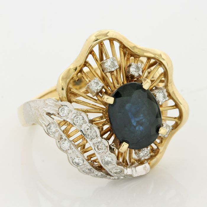 14kt yellow gold 0.25ct round brilliant cut diamond and 3.10ct oval cut sapphire ring; size: 7
